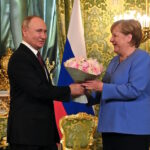 Merkel and Putin discuss foreign forces withdrawal from Libya